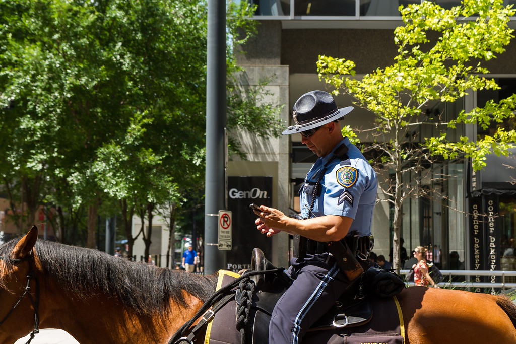 IMAGE: http://alfredomora.smugmug.com/Travel/Houston/i-bDh8t9D/0/XL/20120517-riding-and-texting-XL.jpg